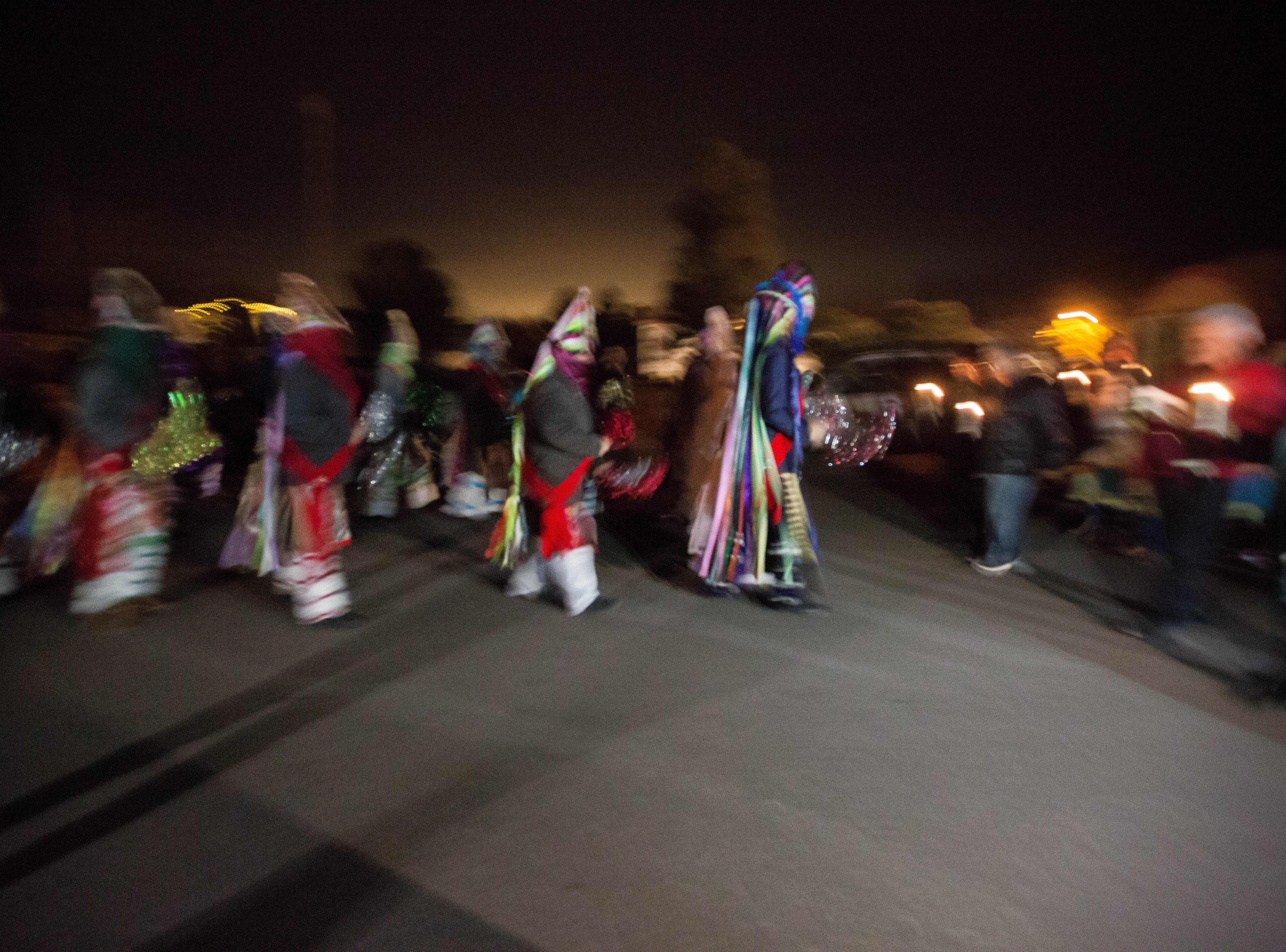 Danzantes and matachines perform traditional dances as the Our Lady of Guadalupe Fiesta starts with candlelight procession from La Capilla to Casa del Pueblo, at the Tortugas Pueblo, early on Tuesday, Dec.r 11, 2018.