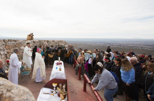 Bishop Emeritus Ricardo Ramirez gives mass on the top of Tortugas Mountain, Tuesday Dec. 11, 2018. During the second day of the Fiesta of Our Lady of Guadalupe,  a pilgrimage is made from the Tortugas Pueblo to the top of the mountain.