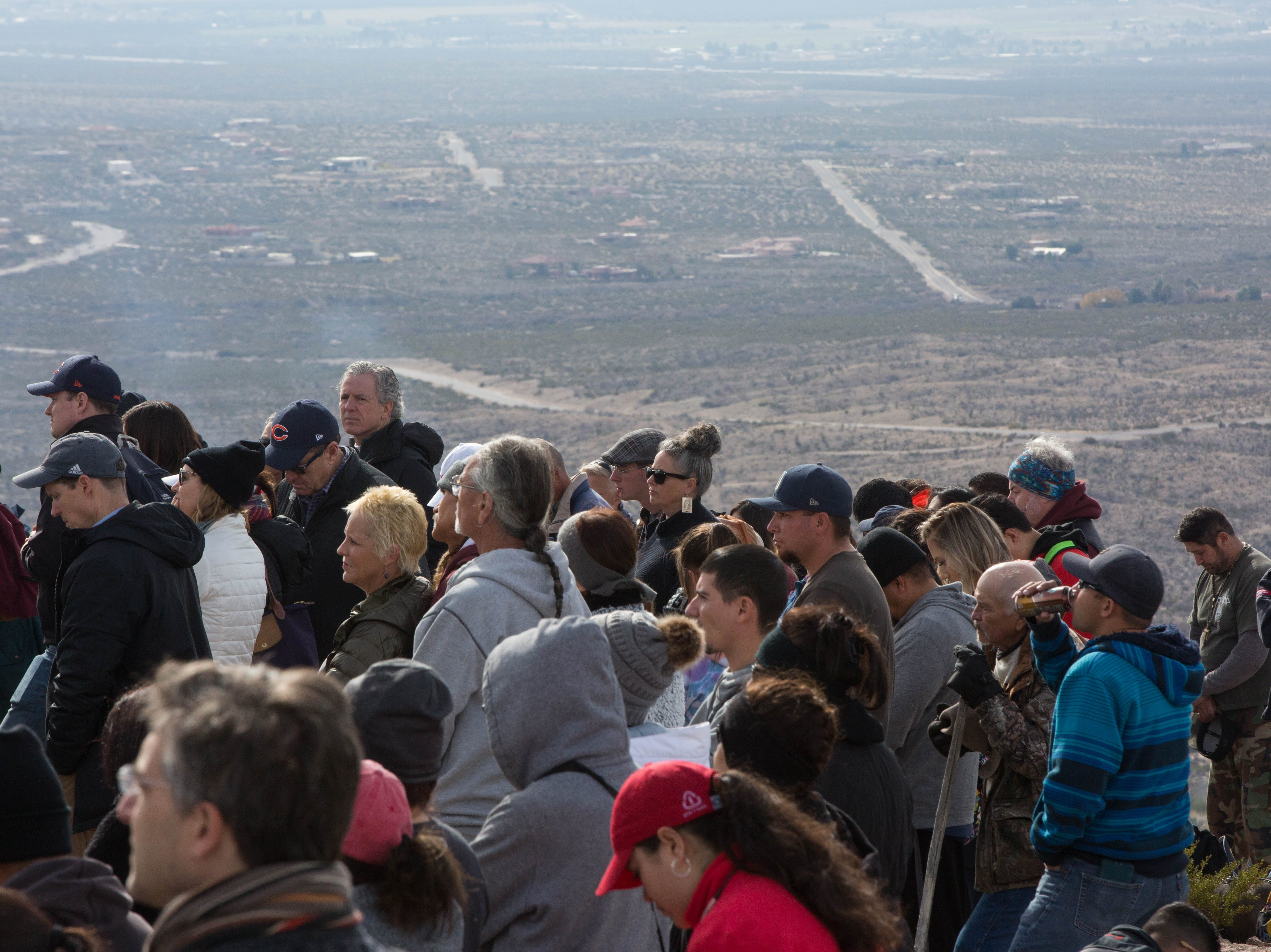 A crowd listens to Bishop Emeritus Ricardo Ramirez (not pictured) as he gives mass on the top of Tortugas Mountain, Tuesday Dec. 11, 2018. During the second day of the Fiesta of Our Lady of Guadalupe,  a pilgrimage is made from the Tortugas Pueblo to the top of the mountain.