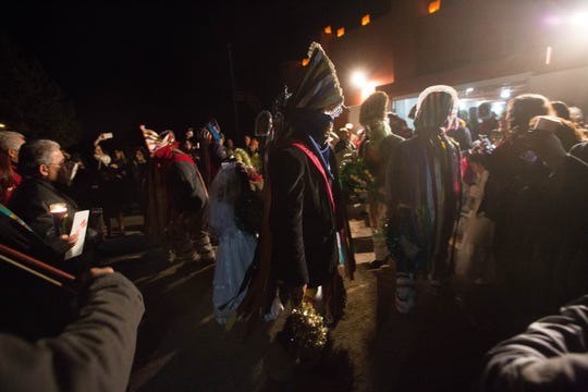 The Our Lady of Guadalupe Fiesta starts with a candlelight procession from La Capilla to Casa del Pueblo, at the Tortugas Pueblo early Tuesday Dec. 11, 2018.