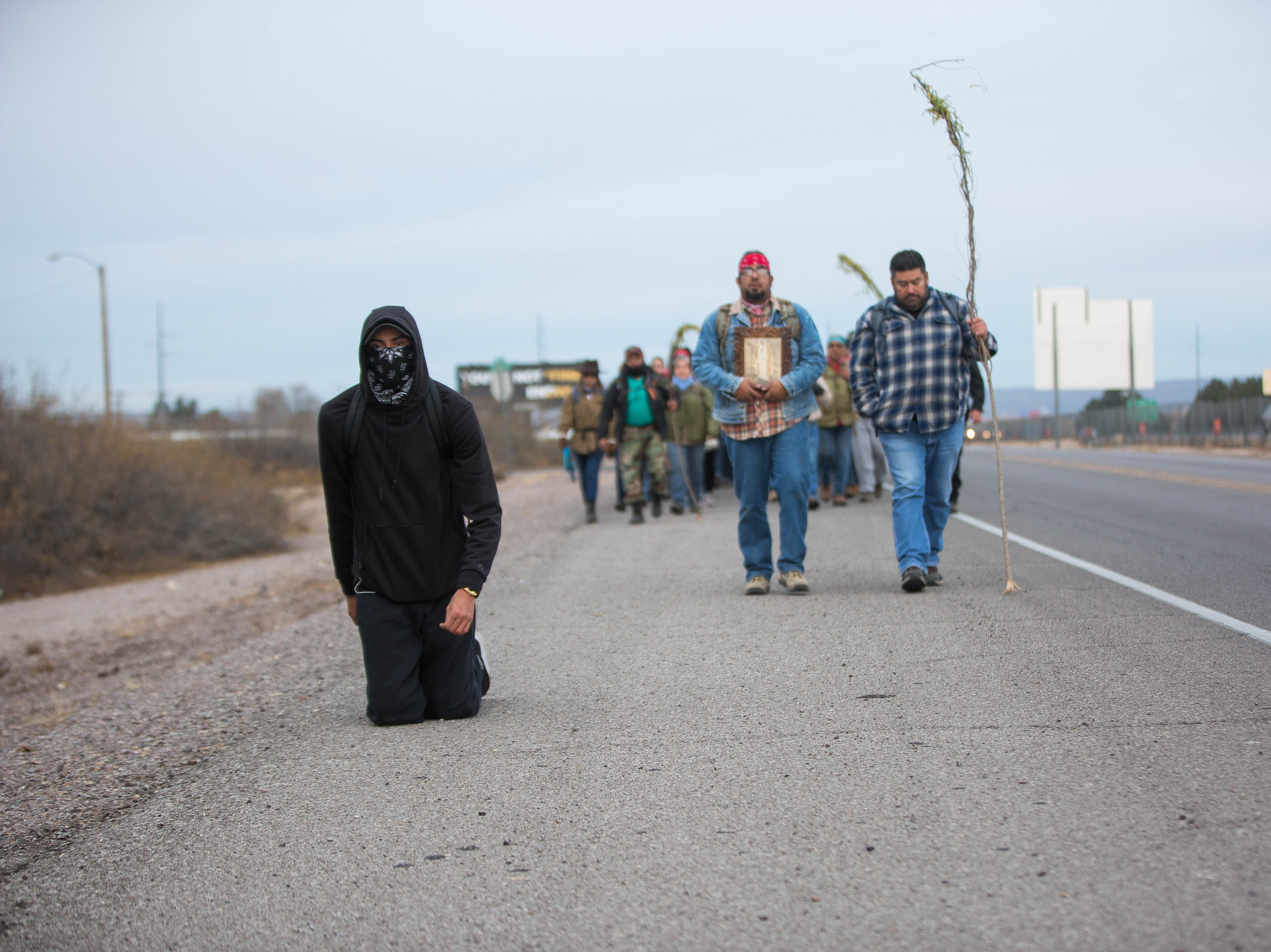 During the second day of the Fiesta of Our Lady of Guadalupe, a pilgrim makes the journey from Tortugas Pueblo to Tortugas Mountain on his knees as penance Tuesday, Dec. 11, 2018. The man did not identify himself to the Sun-News.