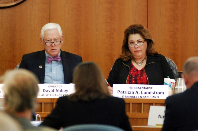 New Mexico state Rep. Patricia Lundstrom, right, D-Gallup, chairwoman of the Legislative Finance Committee, and committee staff director David Abbey hear estimates of state government income on Monday, Dec. 10, 2018, in Santa Fe. A surge in income from the New Mexico's oil sector is providing a financial windfall to state government as the governor's office passes from Republican to Democratic control in January.