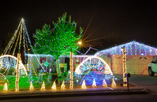 Pictured is a home located at 3364 Ridgeline Drive on Saturday, Dec 8, 2018. The christmas light sync with music that you play on your car radio.
