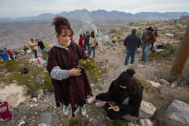 "Sylvia Parra, left, and her daughter Letisha Garcia, right, fashion crosses from yucca and mesquite before the mass on the top of the Tortugas Mountain Tuesday, Dec. 11, 2018.. During the second day of the Fiesta of Our Lady of Guadalupe,  a pilgrimage is made from the Tortugas Pueblo to Tortugas ""A"" Mountain. Pilgrims walk, some barefoot, some carrying shrines and some take the journey while on their knees as penance."