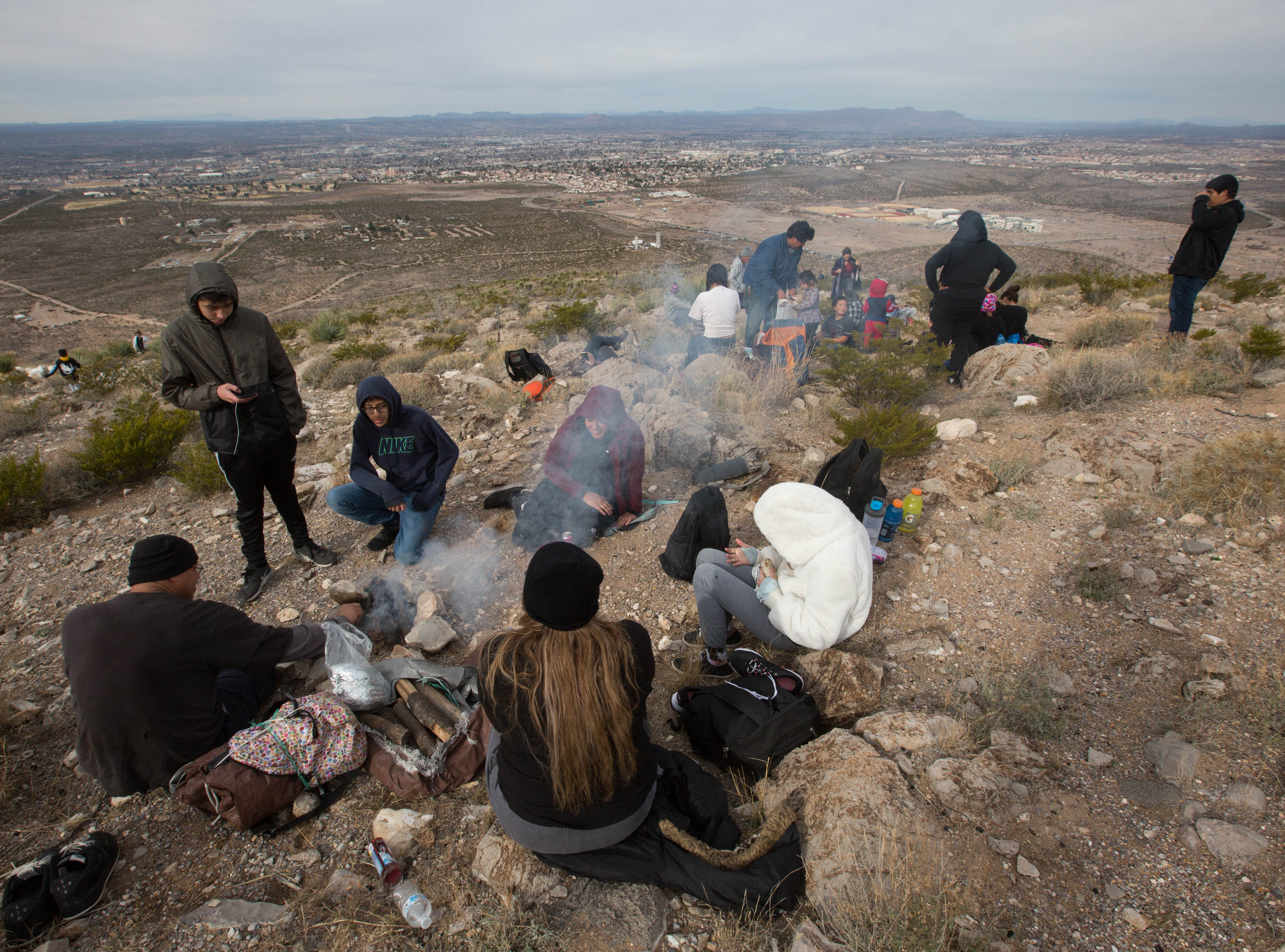 After reaching the top of Tortugas Mountain, many pilgrims start camp fires to cook or warm food before mass starts, Tuesday Dec. 11, 2018.