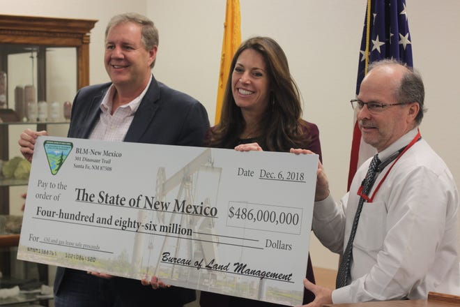 Katharine MacGregor, deputy assistant secretary of land and minerals management at the U.S. Department of Interior presents a check to the State of New Mexico for $486 million in revenue from a recent lease sale, Dec. 11, 2018 at the Bureau of Land Management's Carlsbad Field Office.