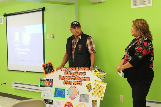 Members of the Crownpoint Chapter emergency response team give their presentation during the luncheon for the Navajo Pride Benefit Fund on Dec. 4 at the Navajo Agricultural Products Industry headquarters.
