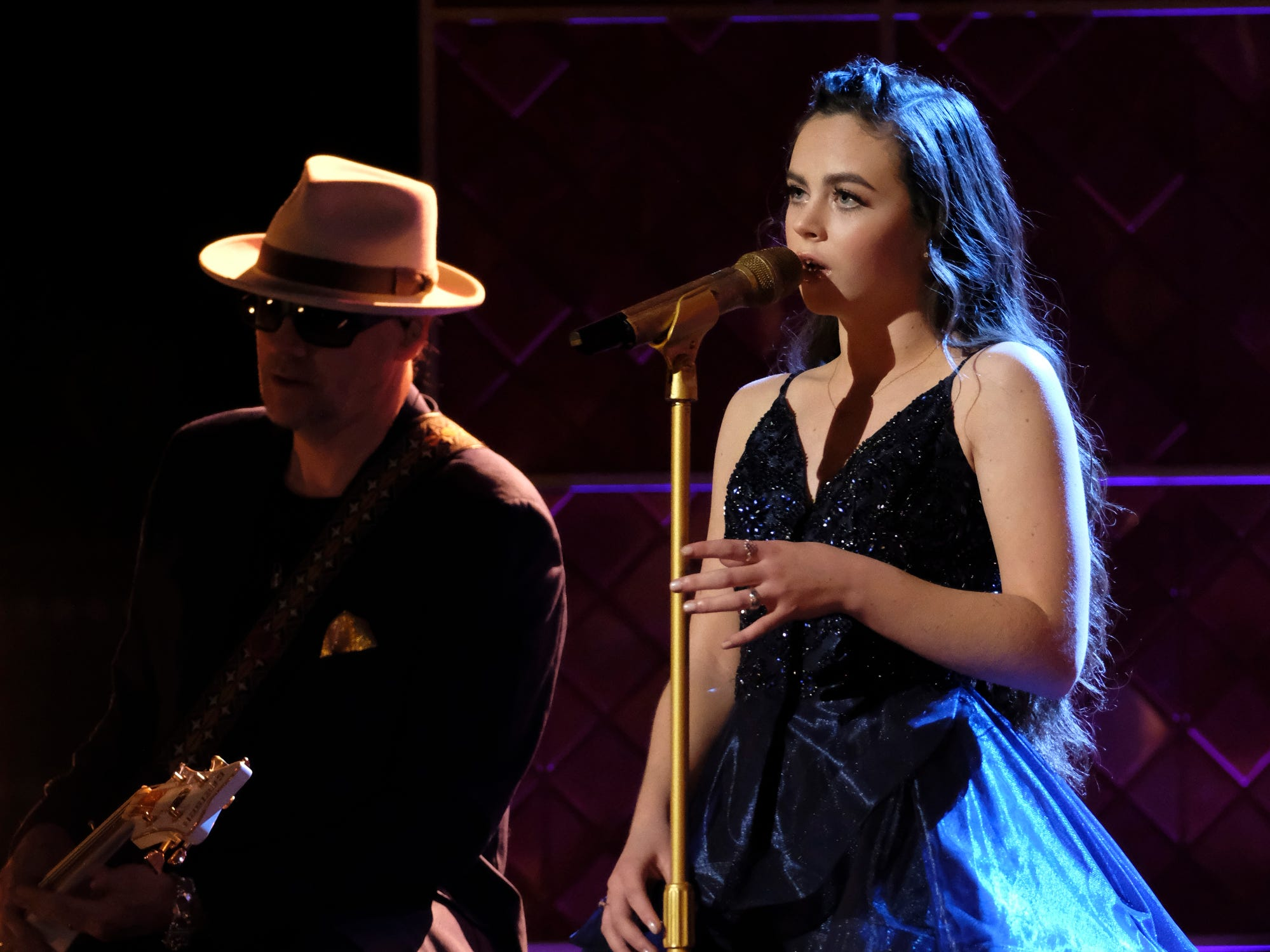 """Chevel Shepherd sang the country classic """"Blue"""" Monday night as hometown fans at a watch party hosted by San Juan College cheers and later gave a standing ovation."""
