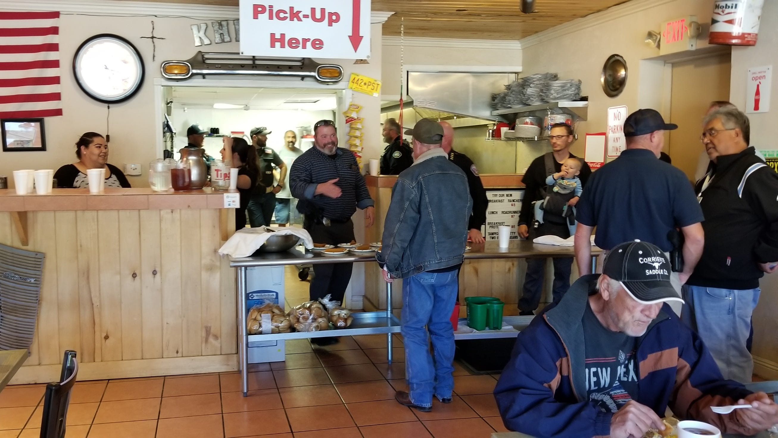 Local law enforcement agencies helped out at the free Thanksgiving meal provided by Bolden and Almador.