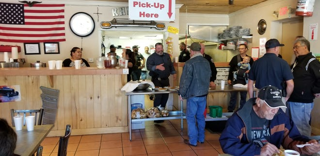 Local law enforcement agencies helped out at the free Thanksgiving meal provided by Bolden and Amador of Old Dog Promotions.