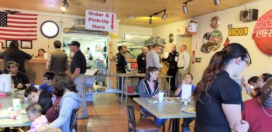 Families and law enforcement officers came together at a free meal provided by Old Dog Promotions during the Thanksgiving holiday.