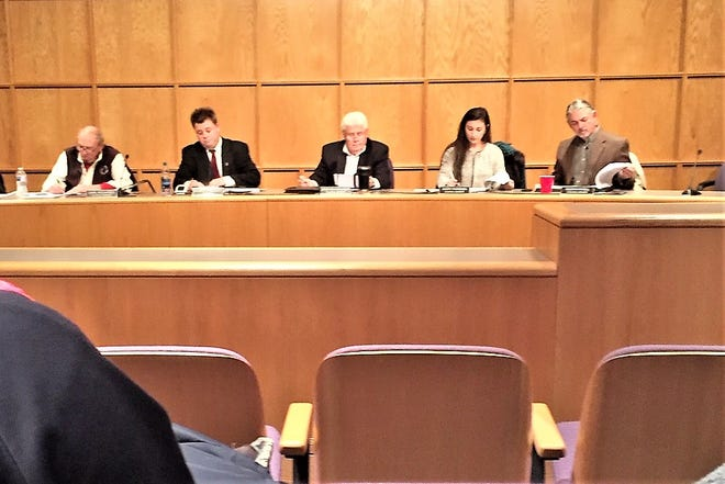 Carl Richards (far left) was seated less than 20 feet from Mary Parisien (second from right) during Monday night's South Lyon City Council meeting.