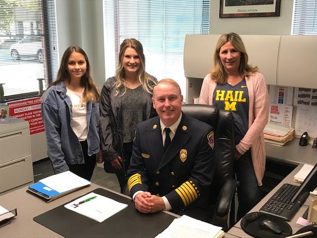 Retiring Birmingham Fire Chief John Connaughton with his family: daughters Caroline (left) and Catherine with wife Katie.