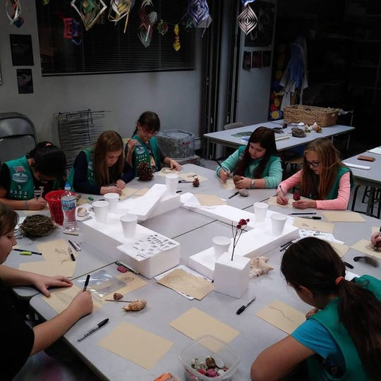Local girl scouts participate in a drawing workshop at the  Plymouth Community Arts Council on Sheldon Road in Plymouth.