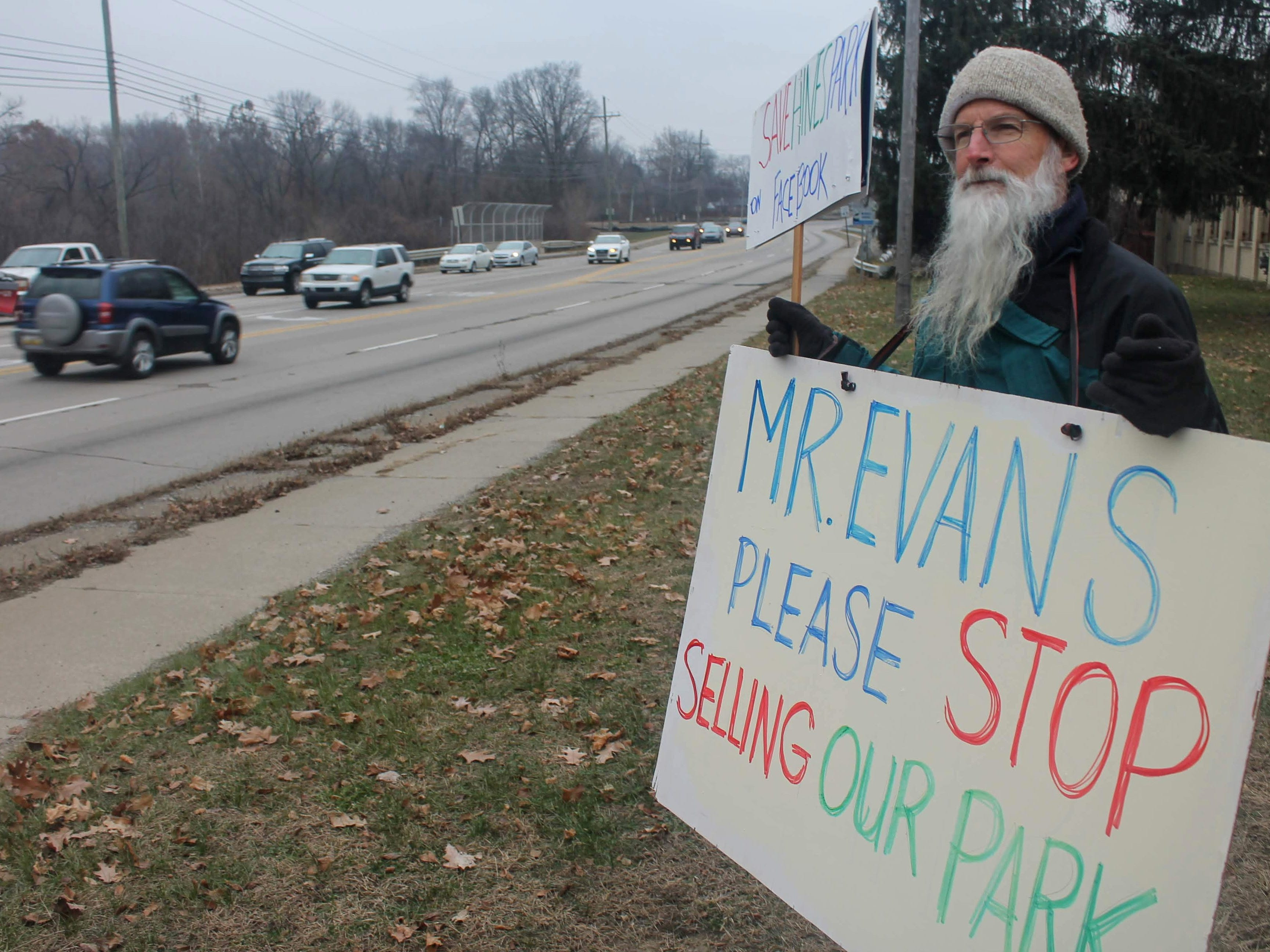 Livonia resident Bill Craig stands outside the Newburgh Mill at Newburgh and Hines Drive in Livonia. Craig and other Wayne County residents are protesting the sale of three mills in Livonia, Plymouth Township and Northville.