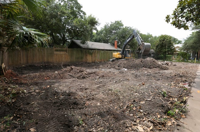 An excavator works on the ground where an old duplex on Hyde Park Boulevard was demolished on Monday, July 30, 2018, in Houston. The residential compound long-rumored to have housed Clark Gable for a stint in the 1920s.