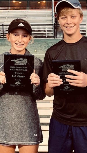 Pensacola's Gabriella Goyins, left, and Justin Lyons at the USTA Florida Seminole County Level 4 Tournament on Dec. 1-4 in Orlando.