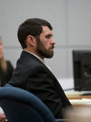 James Greenwood listens Tuesday to opening statements in his murder trial at the Escambia County Courthouse in Pensacola. Greenwood is facing a first-degree premeditated murder charge in the death of his estranged stepfather, Al Jones.