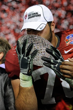Alabama offensive lineman Mike Johnson #78 of the Alabama Crimson Tide kisses the BCS Championship trophy after winning the Citi BCS National Championship game over the Texas Longhorns at the Rose Bowl on January 7, 2010 in Pasadena, California. The Crimson Tide defeated the Longhorns 37-21.
