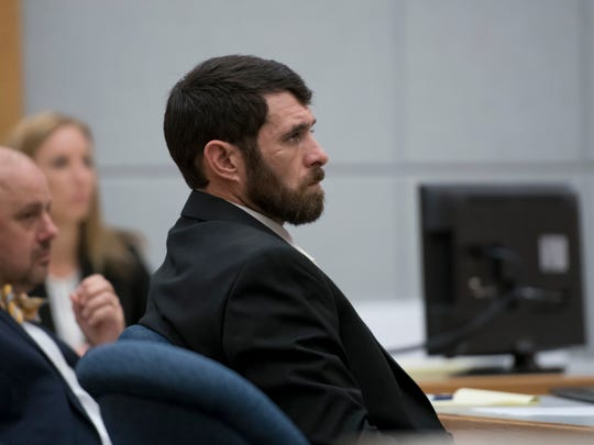 Defendant James Greenwood listens to opening statements at the Escambia County Courthouse in Pensacola on Tuesday, December 11, 2018.  Greenwood is facing a first-degree premeditated murder charge in the death of his estranged stepfather, Al Jones.