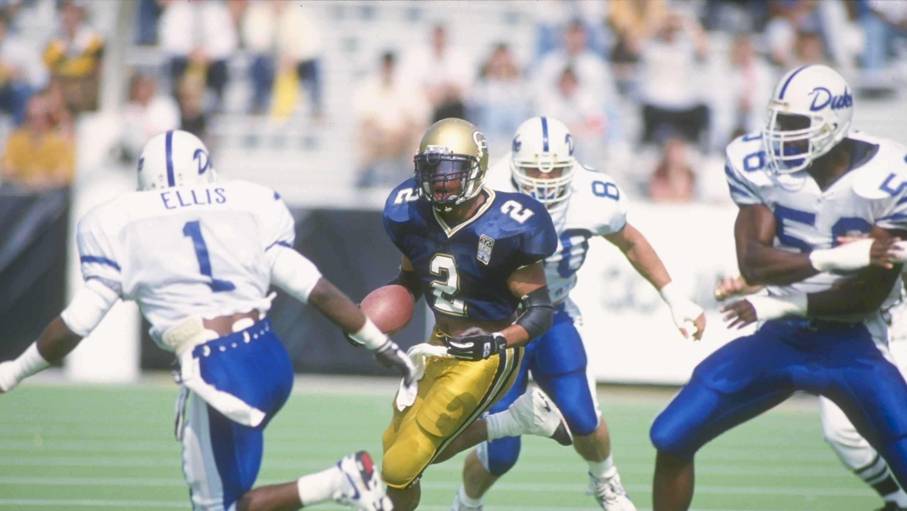 31 Oct 1992: Running back Michael Smith of the Georgia Tech Yellow Jackets runs down the field during a game against the Duke Blue Devils at Bobby Dodd Stadium in Atlanta, Georgia. Georgia Tech won the game 20-17.