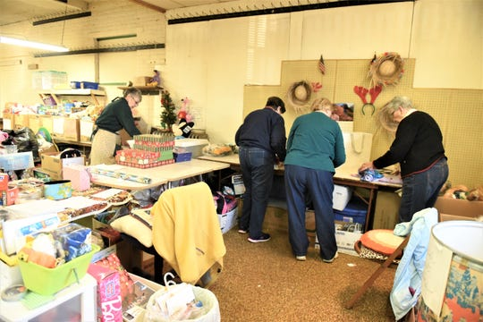 """Some of the """"elves"""" folding pajamas at the Toy Workshop at the Trinity United Church of Christ in Hanover."""