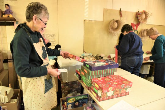Peggy Myers of Spring Grove has been volunteering with her parents at the Toy Workshop for more than 30 years.