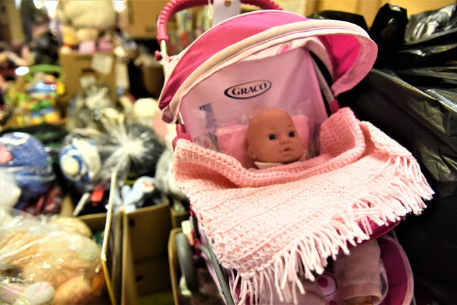 A volunteer hand-crochets blankets that accompany the baby dolls at the Trinity United Church of Christ Toy Workshop in Hanover.