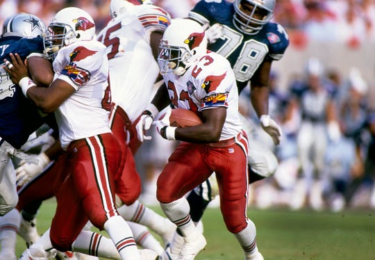 Cardinals running back Garrison Hearst  carries the ball during a game against the Cowboys in 1994 at Sun Devil Stadium.