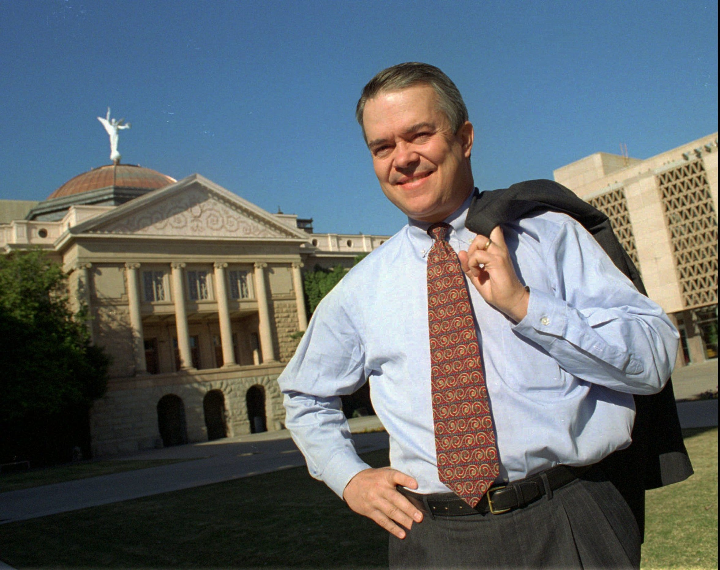 In 1995, State Sen. Tom Patterson poses in front of the Arizona Capitol in Phoenix