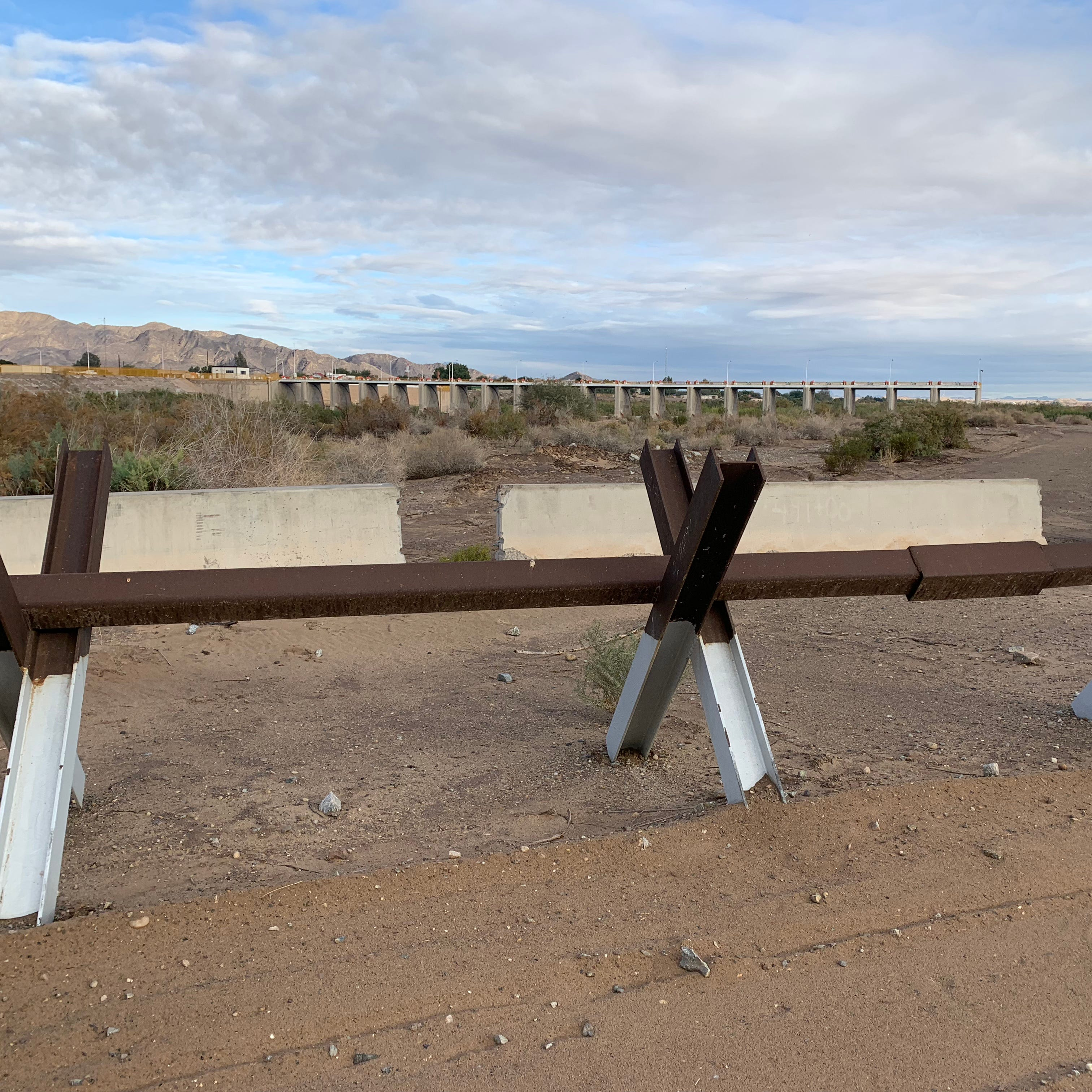 Migrants skirt border fortifications, cross largely unimpeded at the Colorado River