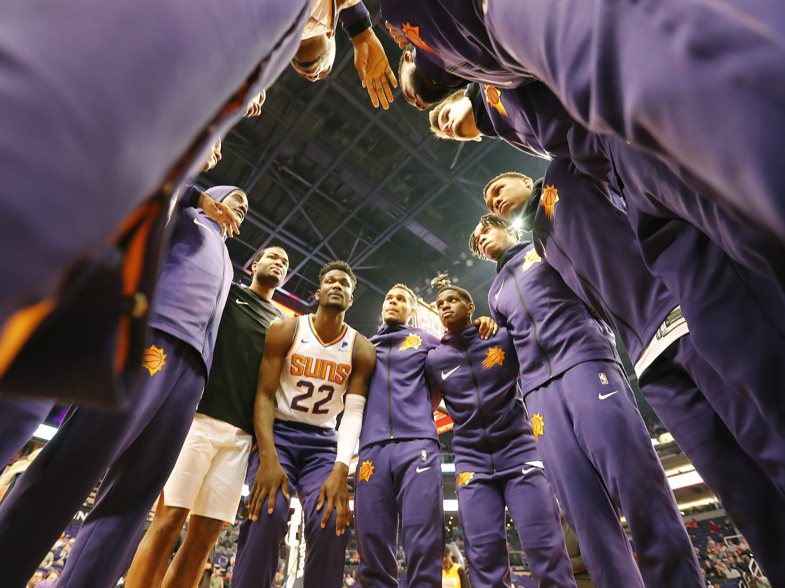 Phoenix Suns players huddle before playing against the LA Clippers in Phoenix, Ariz. December 10.