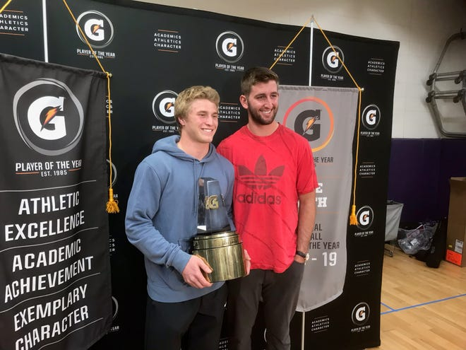 Notre Dame Prep's Jake Smith receives the Gatorade National Football Player of the Year award on Dec. 11, 2018 from Cardinals quarterback Josh Rosen.