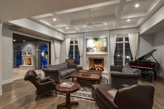 This Scottsdale home features coffered ceilings and multiple fireplaces.