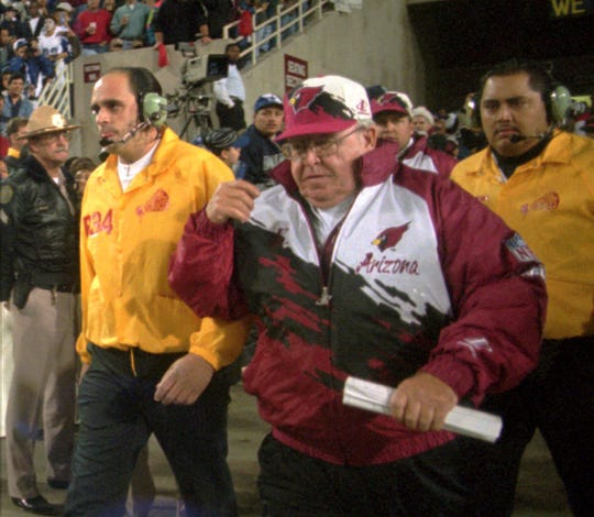 Cardinals coach Buddy Ryan walks onto the field before a Christmas Day game in 1995 against the Cowboys at Sun Devil Stadium.