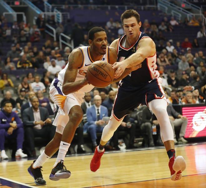 Phoenix Suns forward Trevor Ariza (3) has the ball deflected away by LA Clippers forward Danilo Gallinari (8) during the first half in Phoenix, Ariz. December 10.
