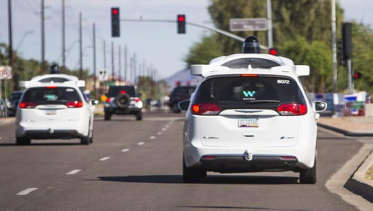 Waymo self-driving vans have been targeted on Phoenix-area roads and freeways, but the company rarely seeks arrests(Photo: Tom Tingle/The Republic)