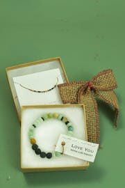 """I love you"" Morse Code necklace ($40) and bracelet ($30) available at Bunky Boutique, before security in Terminal 4."