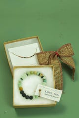 """""""I love you"""" Morse Code necklace ($40) and bracelet ($30) available at Bunky Boutique, before security in Terminal 4."""