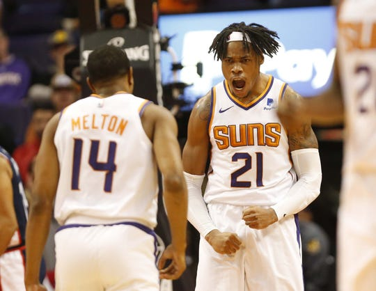 Suns center Richaun Holmes and guard De'Anthony Melton celebrate after a dunk against the Clippers on Monday at Talking Stick Resort Arena.