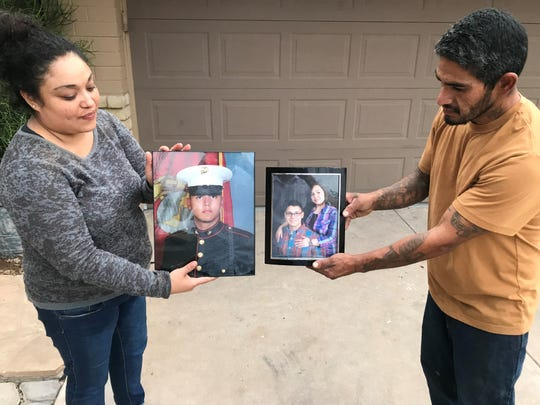 Lorraine Duarte (left) and George Urena (right) hold up photos of Maximo Flores, 27, of Litchfield Park.