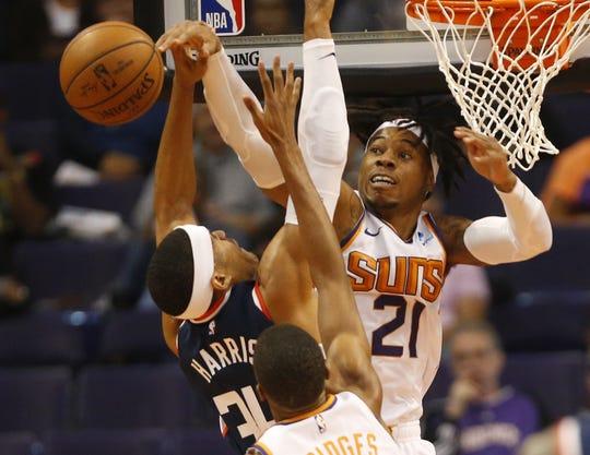 Phoenix Suns forward Richaun Holmes (21) blocks a shot by LA Clippers forward Tobias Harris (34) during the first half in Phoenix, Ariz. December 10.