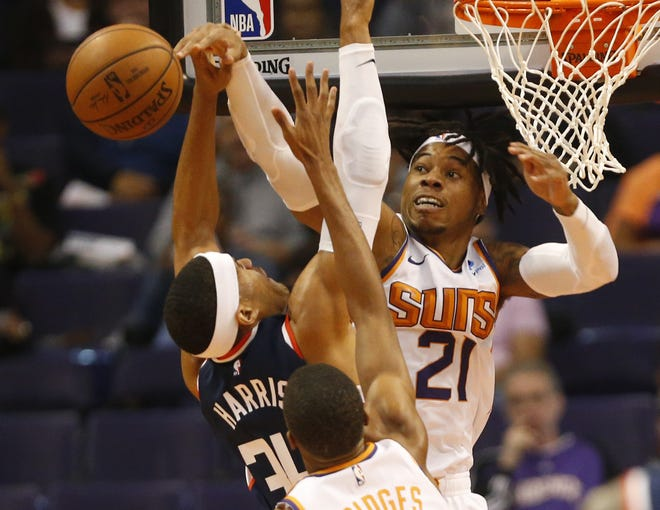 Phoenix Suns forward Richaun Holmes (21) blocks a shot by LA Clippers forward Tobias Harris (34) during the first half in Phoenix, Ariz. December 10.