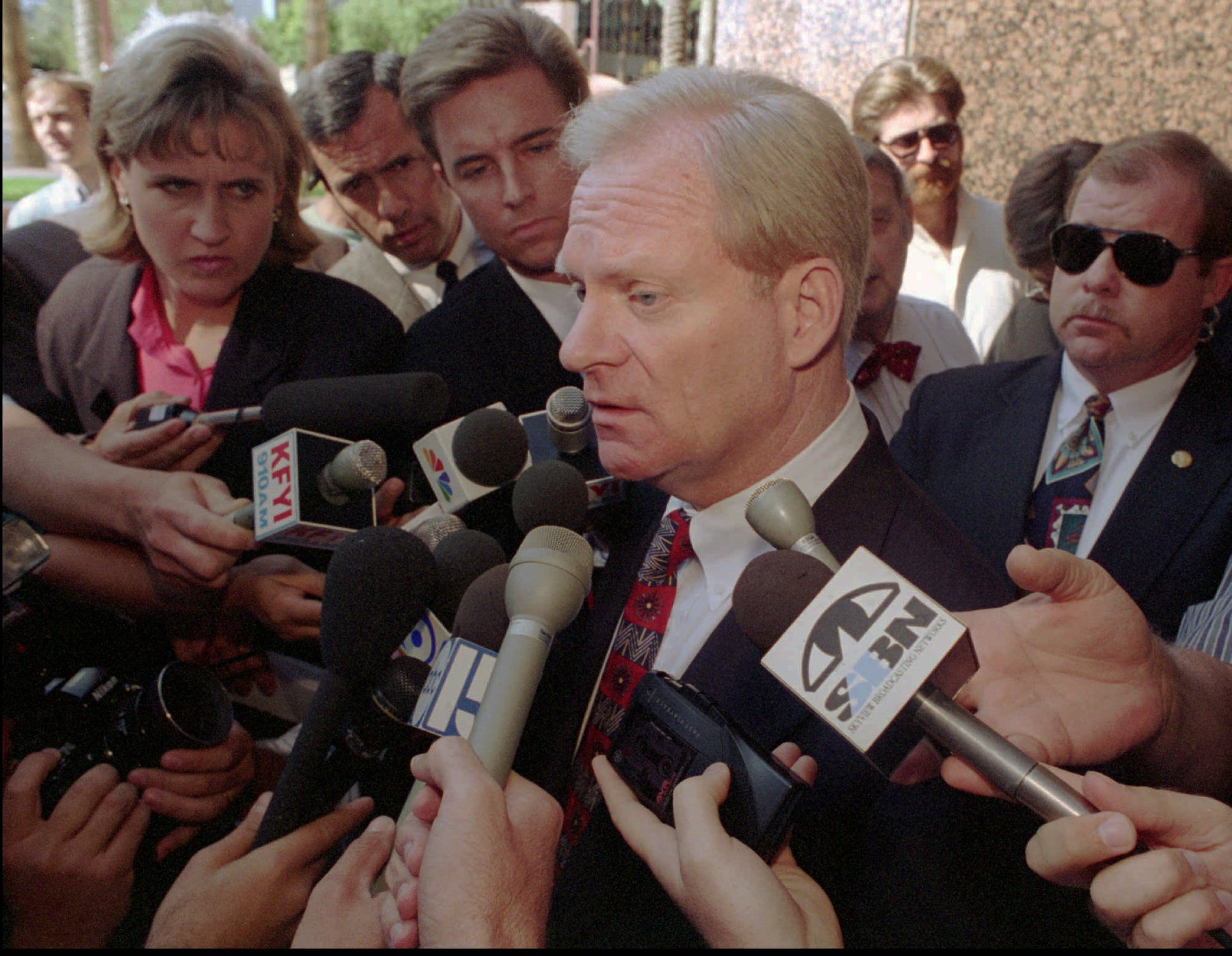 Arizona Gov. Fife Symington responds to questions following a 1995 appearance in federal bankruptcy court  in Phoenix.