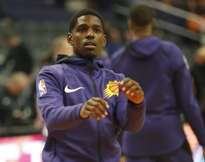 Phoenix Suns guard Jawun Evans (0) warms up before playing against the LA Clippers in Phoenix, Ariz. December 10.