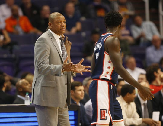 LA Clippers head coach Doc Rivers talks with guard Patrick Beverley (21) during the first half against the Phoenix Suns  in Phoenix, Ariz. December 10.