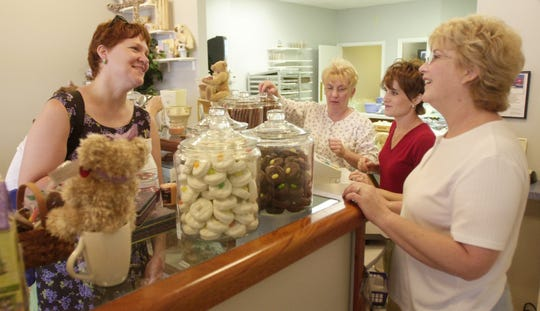 Karen Torgerson, far left, of Milwaukee chats Sunday with Mary Vargo, far right, and her daughter, Darci Vargo, second from right, owners of the Chocolate Harbor in downtown Port Huron. Ms. Torgerson was a passenger aboard the cruise ship Arcadia. Helping out the Vargos was Leann Ladensack. Originally published on June 18, 2001.