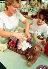 In 2008, Mary Vargo packs a Mother's Day basket as her daughter and co-owner of The Chocolate Harbor, Darci Vargo, looks on.