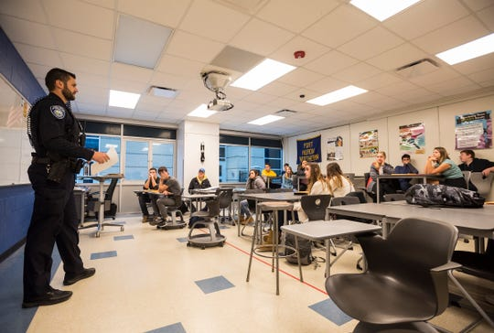 Port Huron Police Officer Dennis Huisman teaches a driver's ed class Tuesday, Dec. 11, 2018 at Port Huron Northern High School.