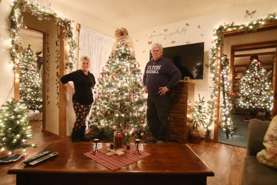 Lori and Wayne Theiss with one of the many Christmas trees in their home in Beacon on December 4, 2018.